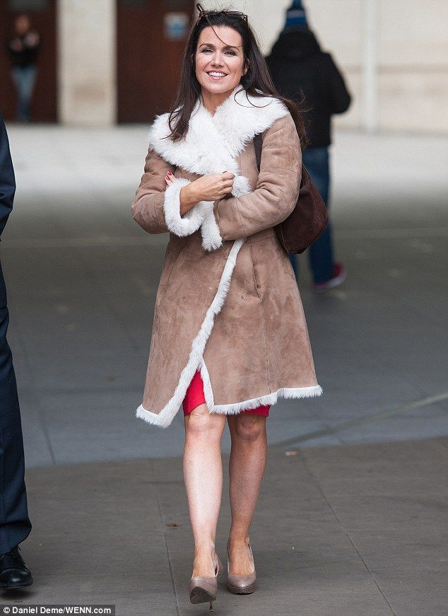 Pavement strut: Susanna Reid kept her coat tightly wrapped around her when she stepped out...