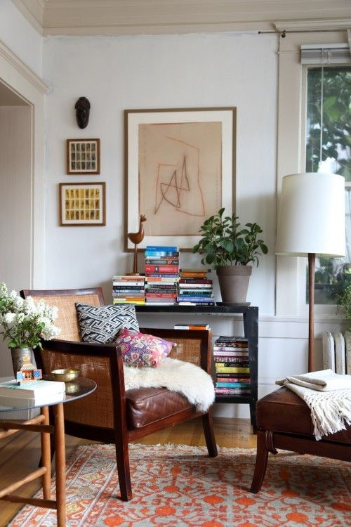 I love this little corner of my living room. Everything started with the rug in this picture and its red and gray muted pomegranate pattern. I dream of having floor-to-ceiling bookshelves someday, but for now my books live on this great little vintage metal console and in my mid-century credenza. The big painting is by an Indian artist named RM Palaniapan and the smaller ones are by Sunil Shree. Shree paints on old train tickets and his art is always about journeys and the process of a…