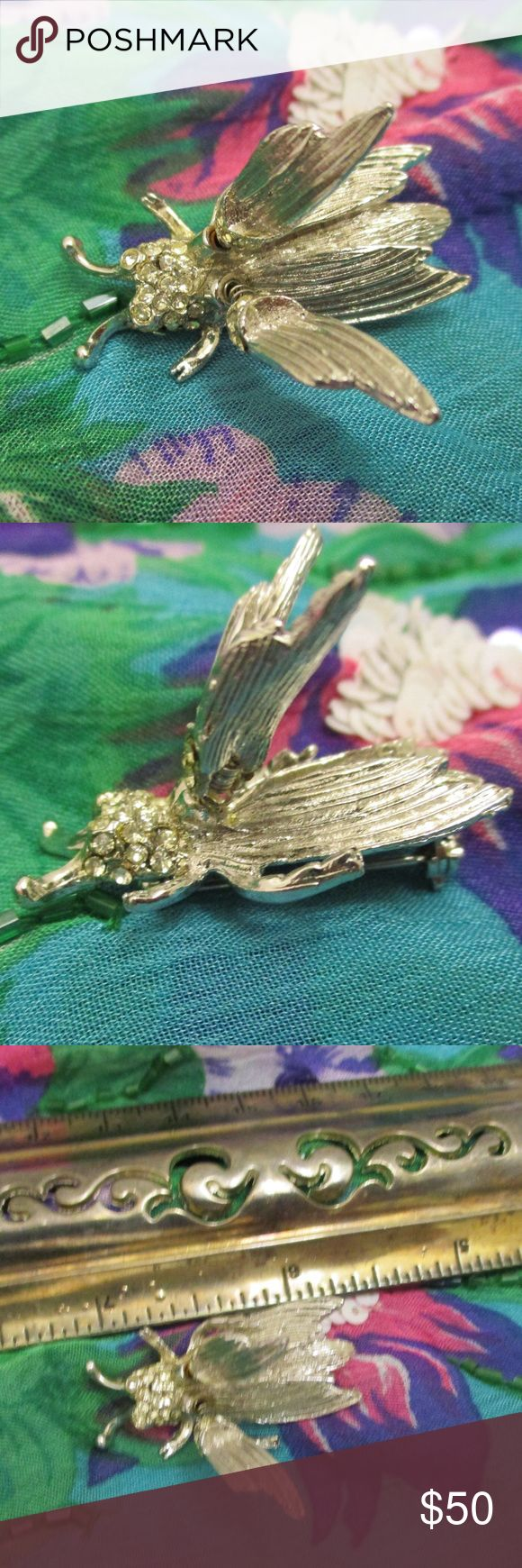 """HATTIE CARNEGIE Insect Bug Trembler Brooch Vintage Presenting a signed designer silver and rhinestone en Tremblant winged bug brooch. This enchanting higly detailed 1960s Hattie Carnegie signed bug trembler is constructed of silver tone metal with faceted clear pave handset rhinestones on head and across top of wings.  Top wings are set on springs causing the wings to jiggle and bounce with every movement ~ thus the term TREMBLER or en Tremblant. 1 1/2"""" x 3/4"""" x 1"""" deep. Secure rollover…"""