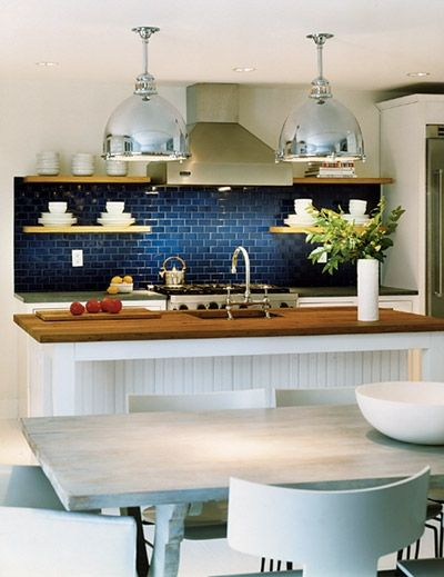Blue and white kitchen. I am usually against the Navy in the house, but