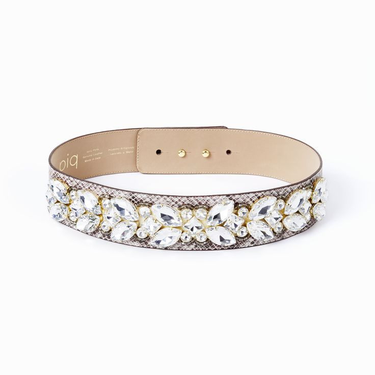 Crystal belt in natural.  Complete your outfit with a piq belt!   Sparkle like a movie star in these beads and crystals which make any outfit an extremely glamorous one! Each stone is applied by skilled hands. The belt is made out of genuine leather by a manufacturer who has been producing leather accessories since 1977! It features a hidden double button closure and can be worn with any piq look.
