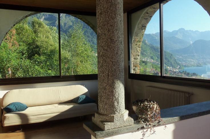 Lake Como Accommodation Panorama Apartment.     Living room: a sofa overlooking the lake