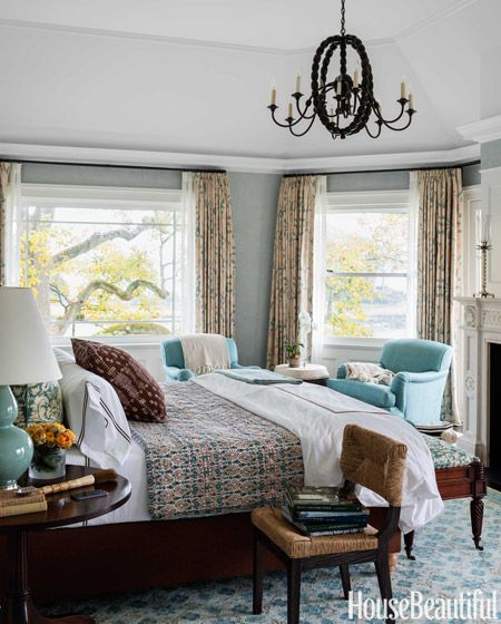 Armchairs are upholstered in Peter Fasano's Hampshire, and the curtains are in Robert Kime's Trebizond. John Robshaw bed linens.
