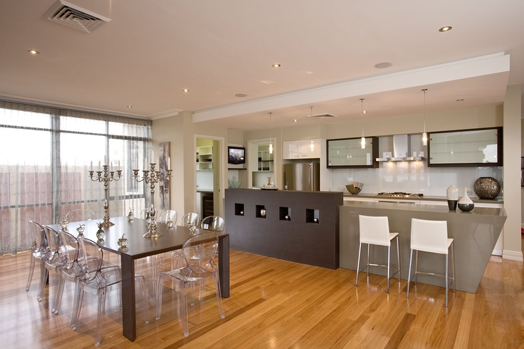 Love the ghost chairs (amongst other things!) in this kitchen and meals area