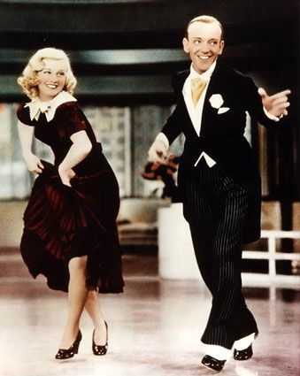 Astaire and Rogers!  Ginger Rogers was one of many famous tap dancing dames that partnered the infamous Fred Astaire...I think the best part is how genuinely happy they both look as they dance.