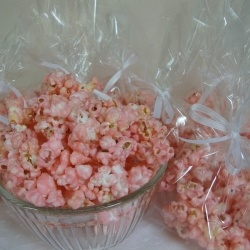 Cotton Candy Popcorn - Tastes just like cotton Candy from the fair and so fast and easy to make 10-12 cups popped popcorn 2 cups sugar 2/3 cups whole milk 2 tablespoons light corn syrup 1/4 teaspoon salt 1 teaspoon cherry flavoring red or pink food coloring.