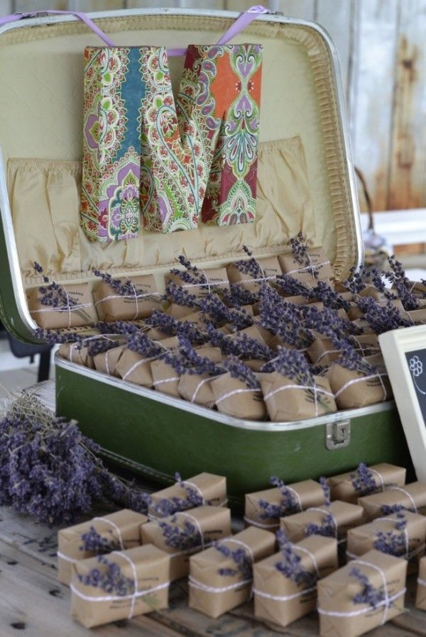 Wedding Favors - Lavender Soap wrapped in kraft paper and twine, topped with a colorful sprig of lavender and displayed in a vintage suitcase.