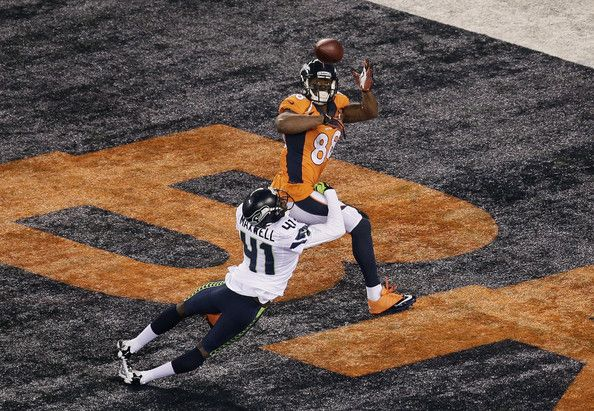 Wide receiver Demaryius Thomas #88 of the Denver Broncos scores on a 14 yard pass during Super Bowl XLVIII against the Seattle Seahawks at M...