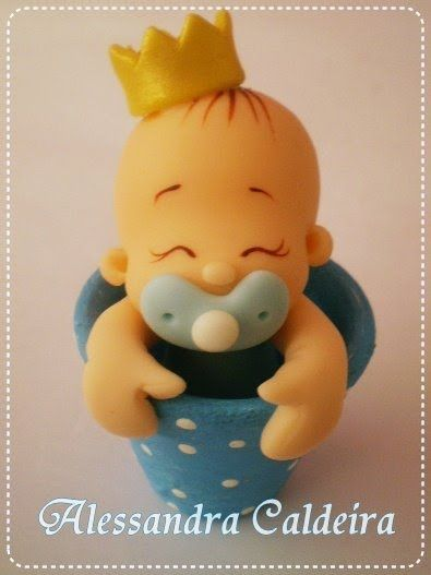 Sweet baby boy with pacy in clay pot