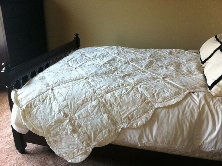 """For our 5th Wedding Anniversary, my mom made us a """"Wedding Ring"""" quilt out of her dress and my mother in law's dress.  It is probably the most special thing I own."""