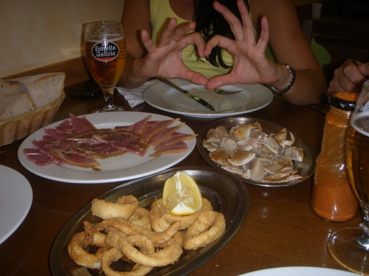 Calamari rings, lacón (shoulder of pork) and Galician oreja in Santiago de Compostela (Spain)