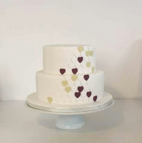 Hearts tiered wedding cake purple green hearts. Fondant