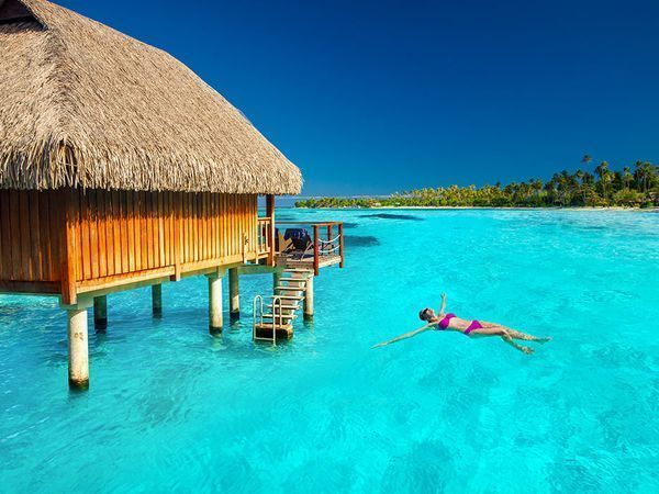 Dreaming of staying in an overwater bungalow? These options, in destinations from Mexico to the Maldives, go for less than you'd think.