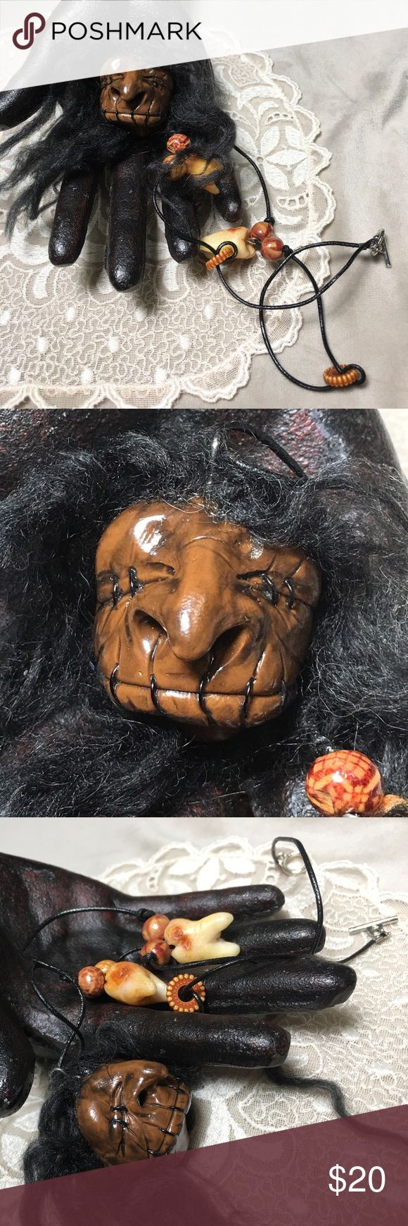 """Handmade Shrunken Head W/ Rotting Teeth Necklace Shrunken head pendant on black cord accompanied by wood beads and faux rotten teeth. Handmade. This fella has a huge nose and is quite the character! Hair is mohair. Measures 20"""" long and has a toggle clasp. Pendant is 1.5"""" long and 1.5"""" wide. Handmade Jewelry Necklaces"""