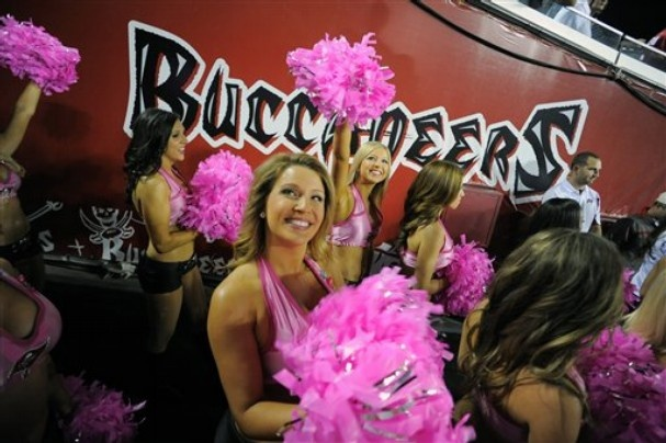 Tampa Bay Buccaneers cheerleaders, wearing pink to support Brest Cancer Awareness Month, wait in the tunnel at the start of NFL football game against the Indianapolis Colts on Monday, Oct. 3, 2011, in Tampa, Fla. (AP Photo/Brian Blanco)