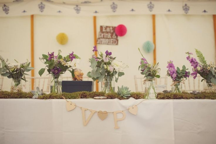 Gorgeous jam jar flowers within one of our LPM Bohemia tents