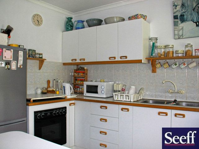 "This lovely double storey family home will truly give you that Victorian feeling because of its beautiful design with a spacious loft can be two extra bedrooms or bedroom and study or workroom. Very comfortable kitchen with breakfast nook and lots of cupboards and pantry under steps. Large carpeted main bedroom with build in cupboards and en suite bathroom with shower. Large Covered patio facing a lovely garden. All in an exceptional peaceful area. Contact Anton 073 344 3242 Seeff ref no""…"