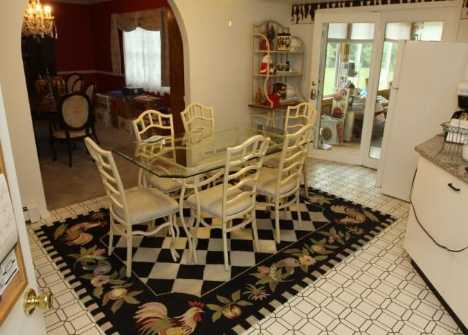 """Beveled glass top table with metal base 66"""" x 40"""" x 30""""T, six metal side chairs having upholstered cushions, metal four shelf bakers rack having one wooden shelf and two glass shelves 36"""" x 17.75"""" x 73""""T, machine made rug approx 9'2"""" x 7'3"""", and metal wine rack with woven wicker top 32"""" x 13"""" x 32.5""""T. Buyer must take all. Excluding contents."""