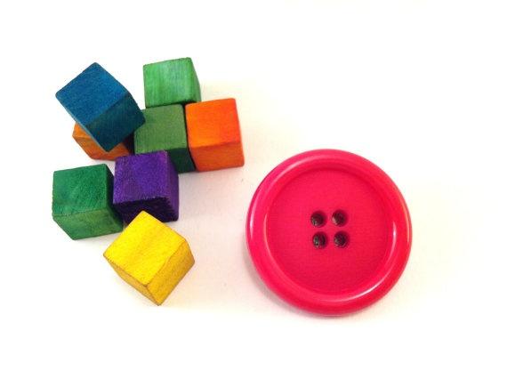 Pink button brooch
