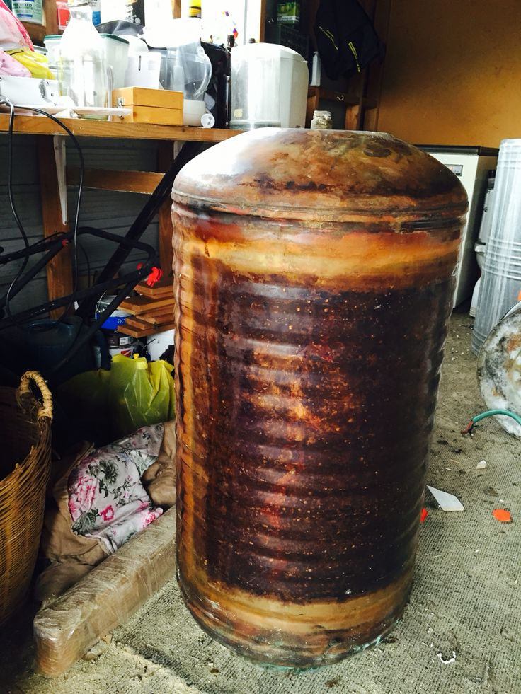 Old hot water tank for charcoal BBQ