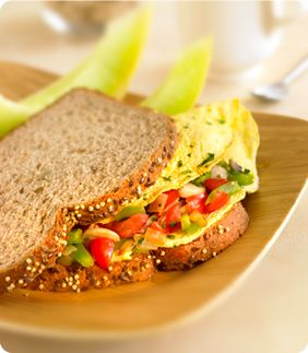 Breakfast Omelet SandwichesServes: 2 Here's a hearty and tasty breakfast idea.  You can make a savory vegetable omelet even better by sandwiching it in between slices of whole grain bread.