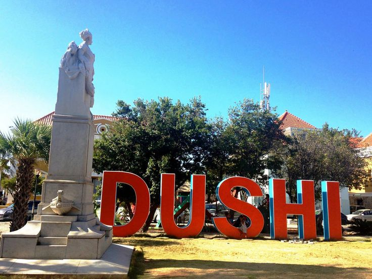 """""""Dushi"""" is a word often heard in Curacao that means """"sweet."""" The Dushi sign in downtown Willemstad is popular with adults and children alike. (Photo by Nicole Pensiero)"""