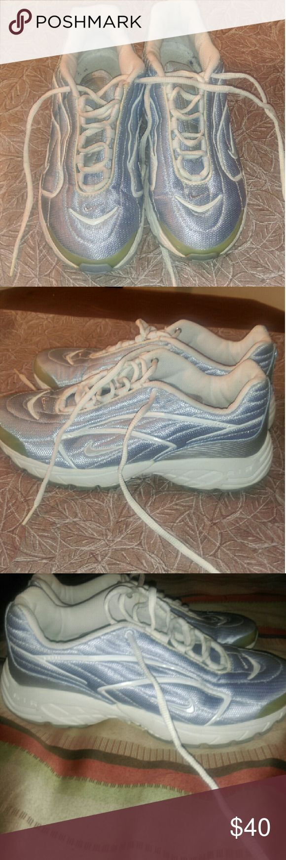 Ladies sz 9.5 light blue&white running shoes Ladies sz 9.5 light blue&white running shoes, these shoes are in excellent condition....no signs of wear and tear... Nike Shoes Athletic Shoes