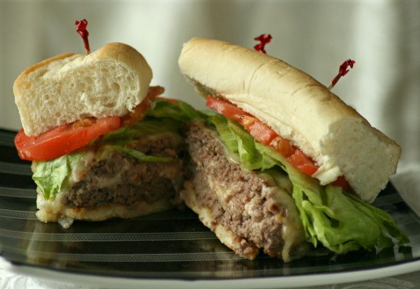 I got this recipe from a grilling cookbook.  I thought I was in burger heaven when I took a bite of this hamburger.  The cream cheese just seeps out of these garlic burgers.  Mmmm... their good!