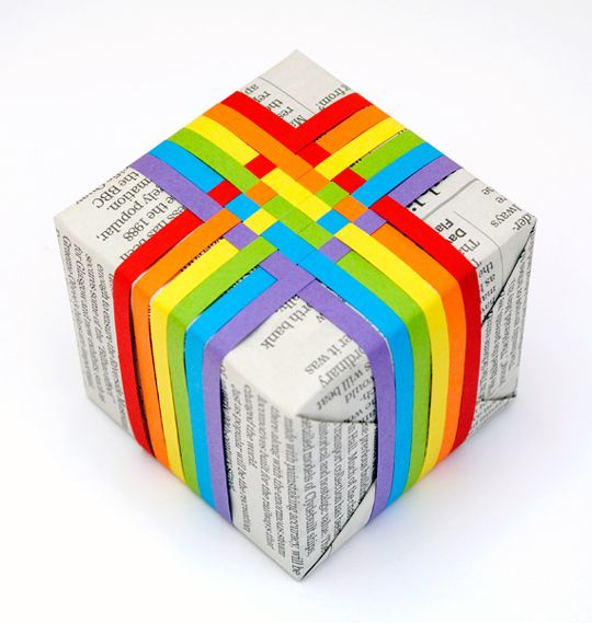 Woven rainbow gift topper - strips of paper woven & taped over newspaper. Very cheerful!