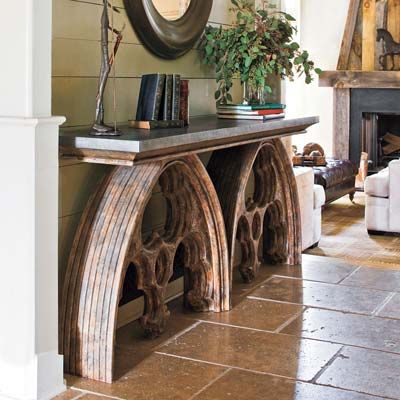 Build a Window-Arch Console Table for a Welcoming Entry - Give guests extra space to put down drinks with a console table that has true one-of-a-kind appeal. Support the bluestone and wood top with some sculptural finds from a salvage yard—like the weathered Gothic arches used here.