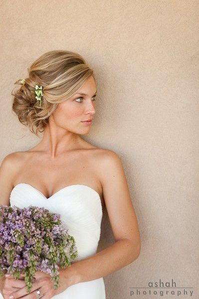 wedding hairstyle - up-do, with volume on top and low, messy gathering at neck.