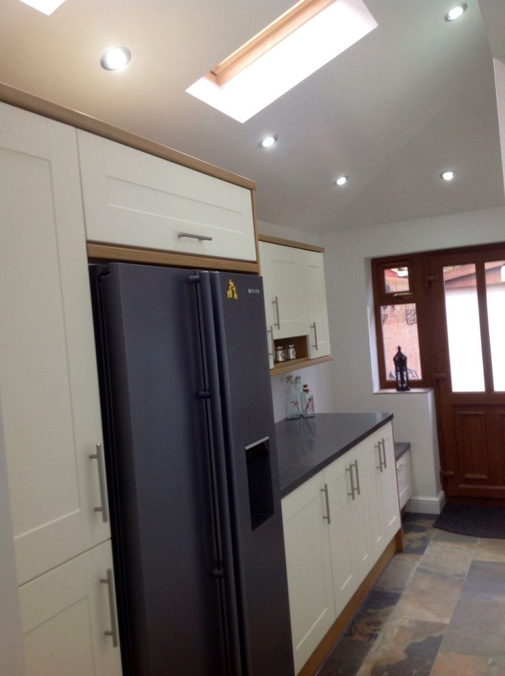 Small utility space. ,,, American fridge freezer