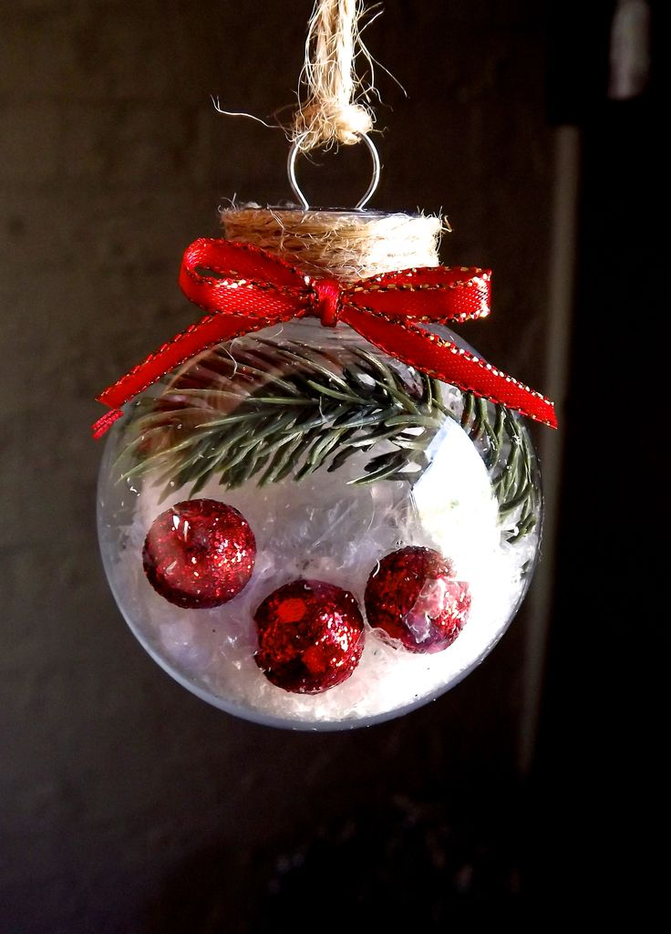 Christmas decoration filled with plastic pine foliage, fake snow and mini red polystyrene glitter balls; finished off with hessian twine and red and gold ribbon bow.  Plastic fillable bauble