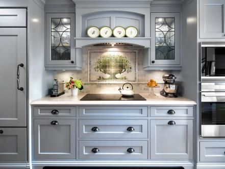 A blue traditional kitchen with contemporary flair and whimsical touches is what the client desired.