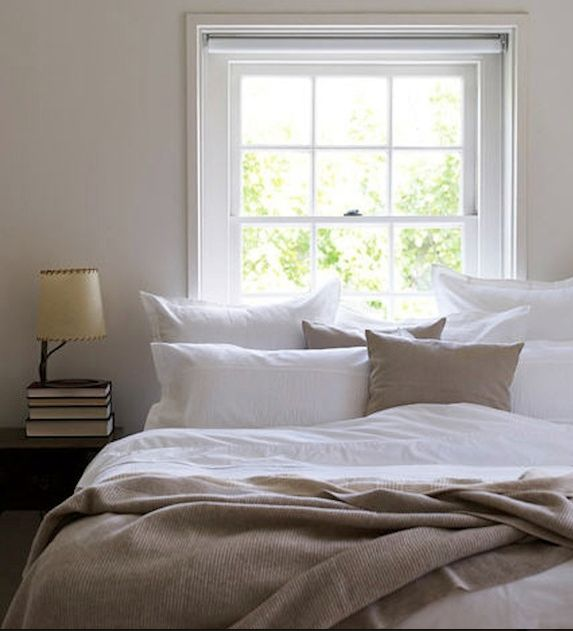 Small bedroom, bed in front of window--I think we should do this..