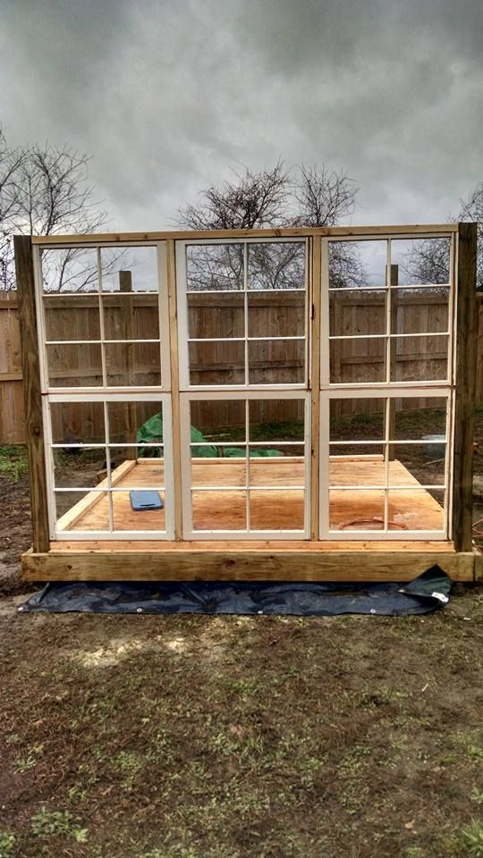 Greenhouse out of old windows. I really want to do this.