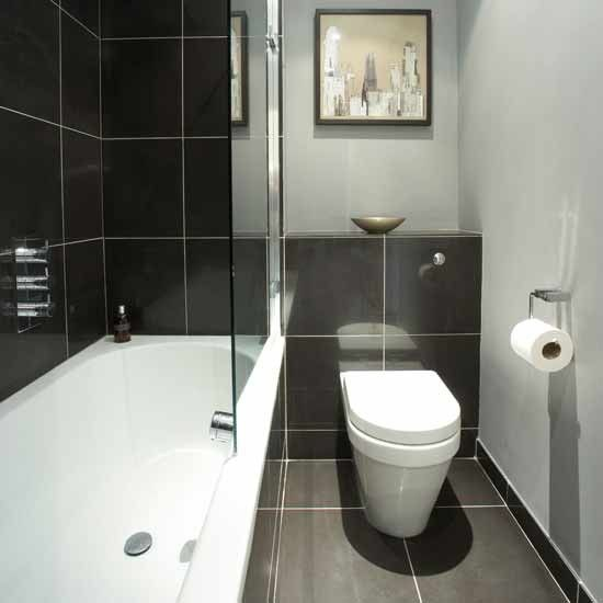 Small monochrome bathroom - Go for a black, white and grey colour scheme to get that hotel-chic look in a small bathroom. Here, black bathroom tiles add definition to the soft grey walls, and a glass shower screen gives the illusion of more space - ideal for narrower bathrooms.