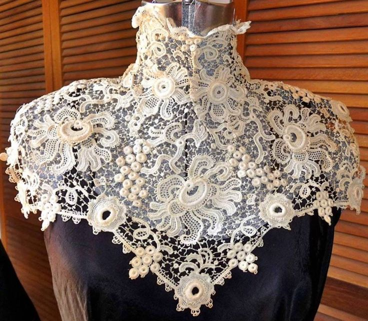 This gorgeous Irish crochet collar dates to the 1910s - very Edwardian. The collar features traditional Irish crochet patterns, including roses, crescent moons, grapes and four petal flowers.  This was for sale on Etsy for just $85 USD. Image courtesy of https://www.etsy.com/listing/111806930/late-victorian-early-edwardian-downton