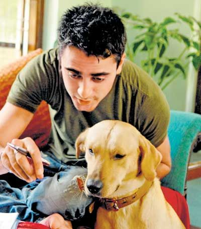Imran Khan with his pet Labrador Tony who passed away in 2011 due to food poisoning. Pic/mid-day archives | #indipin