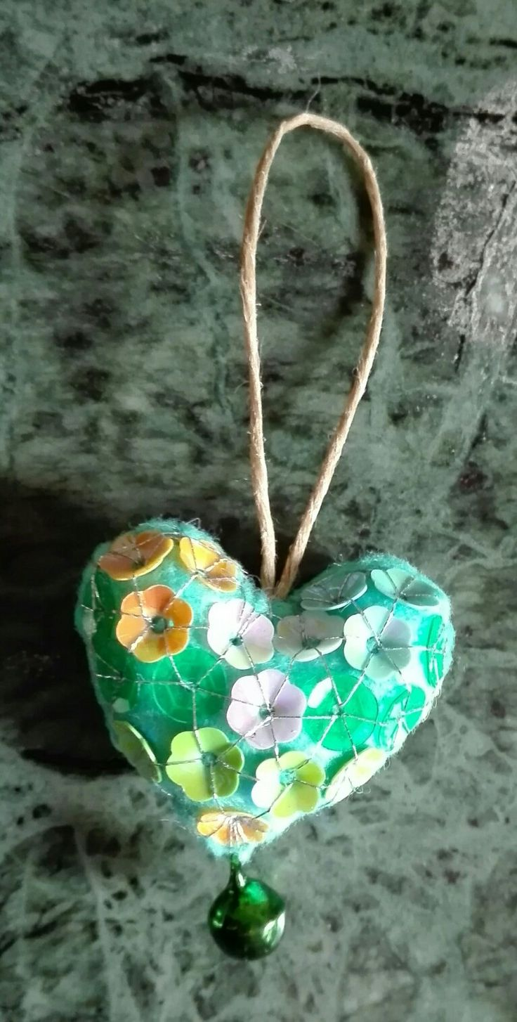 heart for giovanna - 3 april 2017 - handmade by mariarosa, green felt, bell and 28 flowers paillettes.