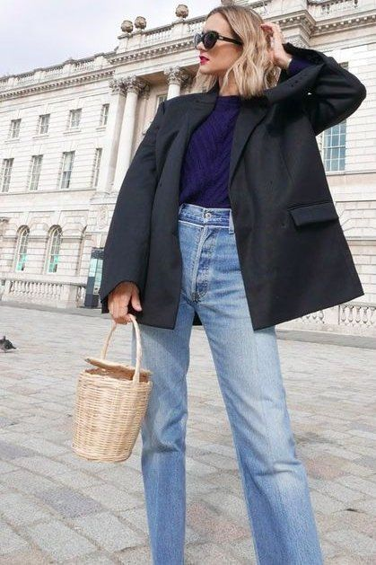 Loving this black oversized blazer, styled with mom jeans and accessorized with a straw bag.