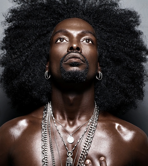 Mbaya Guez - I am not familiar with who this brother is but his ebony skin is amazing and his hair...wow, he definitely rocks!