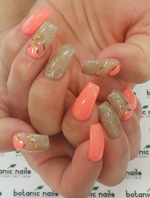 Level up your chevron nail art on a coffin nail with this beautiful and elegant metallic gold, gold glitter and peach design.