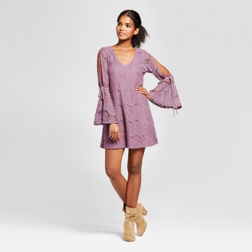 Elevate your collection of going-out dresses with the Lace Tie-Bell-Sleeve Dress from Lots of Love by Speechless. In a beautiful mauve, this dress has romantic charm written all over it — with the lace overlay, playful bell sleeves and cut-out detail, you'll look as darling as you feel. The relaxed silhouette provides you with a flattering fit while the soft cotton blend keeps you comfortable anywhere you wear it. Amp up your style game for date night by pairing it with metallic...