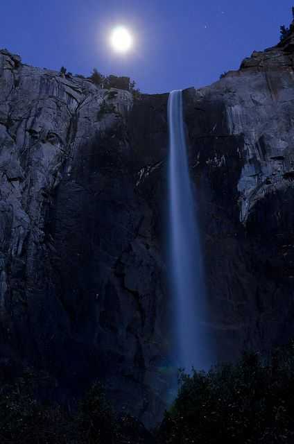 Moon light over Yosemite National Park waterfall, California, United States