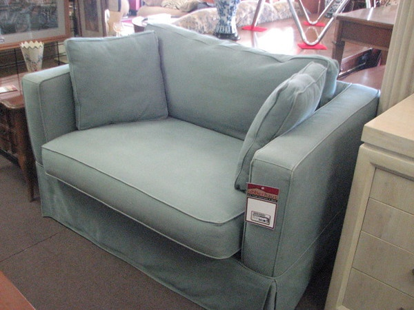 Upholstered Short Loveseat Or Oversized Chair Featuring Powder Blue Fabric  And Two Throw Pillows $135.