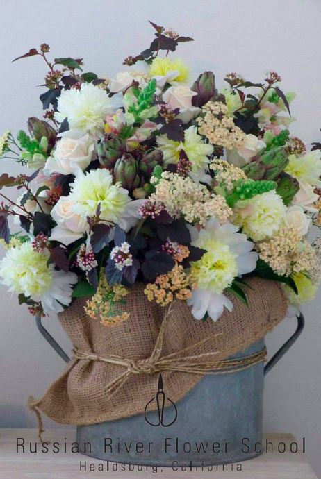 """An arrangement for a private party today. The client asked for something """"very seasonal"""" so, since it is peak season for both peonies and artichokes, they were used in the design. The bouquet is in vintage milk bucket with burlap and seagrass. Designed by Dundee Butcher  #Peonies #Artichokes #RussianRiverFlowerSchool #FloralDesign"""