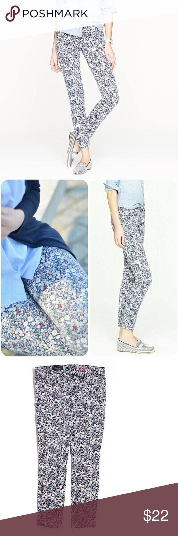 """Crew Liberty toothpick jean in June Meadow floral Gently used. Good shape. The same toothpick jean you know and love, crafted in a floral motif. Freshly picked from London's Liberty Art Fabrics , this hand-drawn print features a smattering of exotic flowers from the famed Abbey Gardens, located on the small island of Tresco off the coast of the UK. True to size. Sits lower on hips. Slim through hip and thigh, with a skinny, cropped leg. Cotton with a hint of stretch. 26"""" inseam. 7"""" rise. 30""""…"""