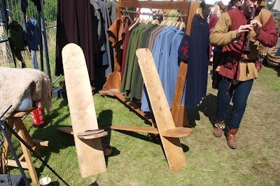 Foldable chairs made from two wooden planks.
