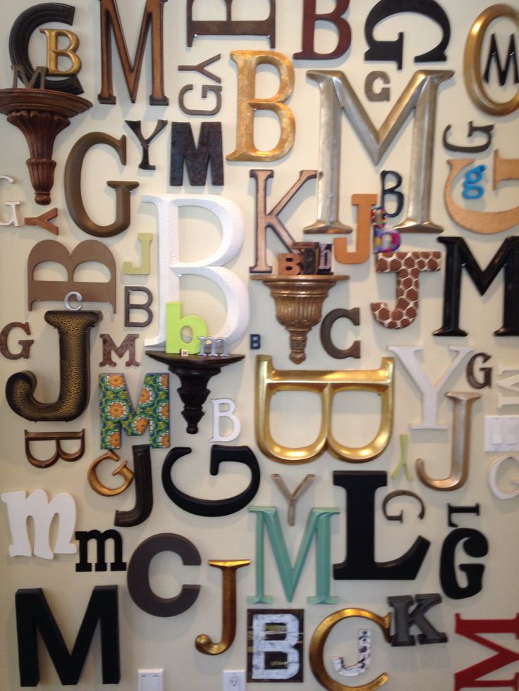 gallery wall of family initials